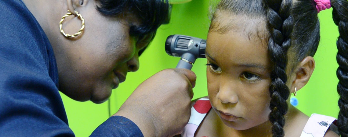 young girl ear being checked